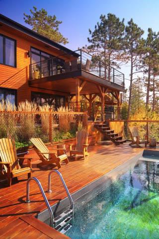 Maison dans les bois avec piscine